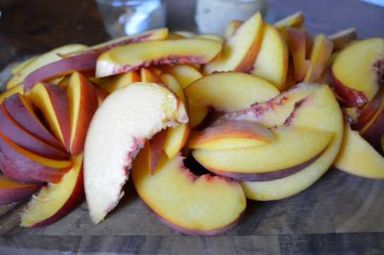 Peachy Keen Peaches and Biscuits | OhMyPotluck.com